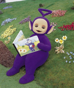 Tinky Winky reading a book